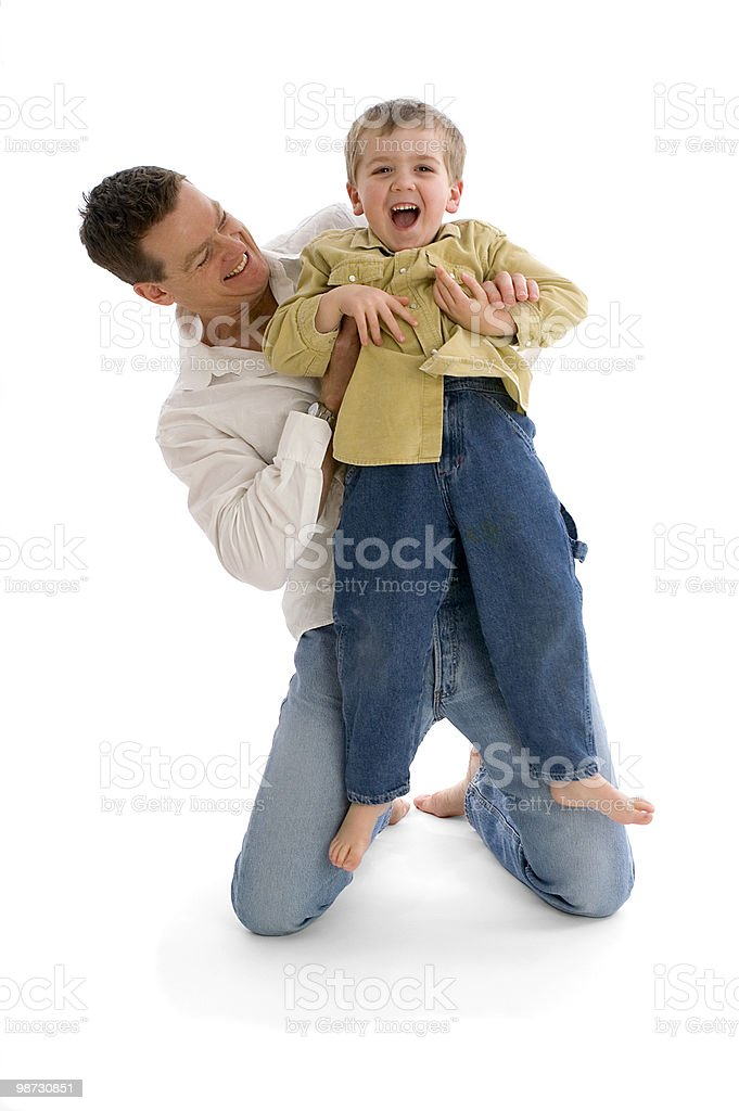 Father playing with his son both laughing royalty-free stock photo
