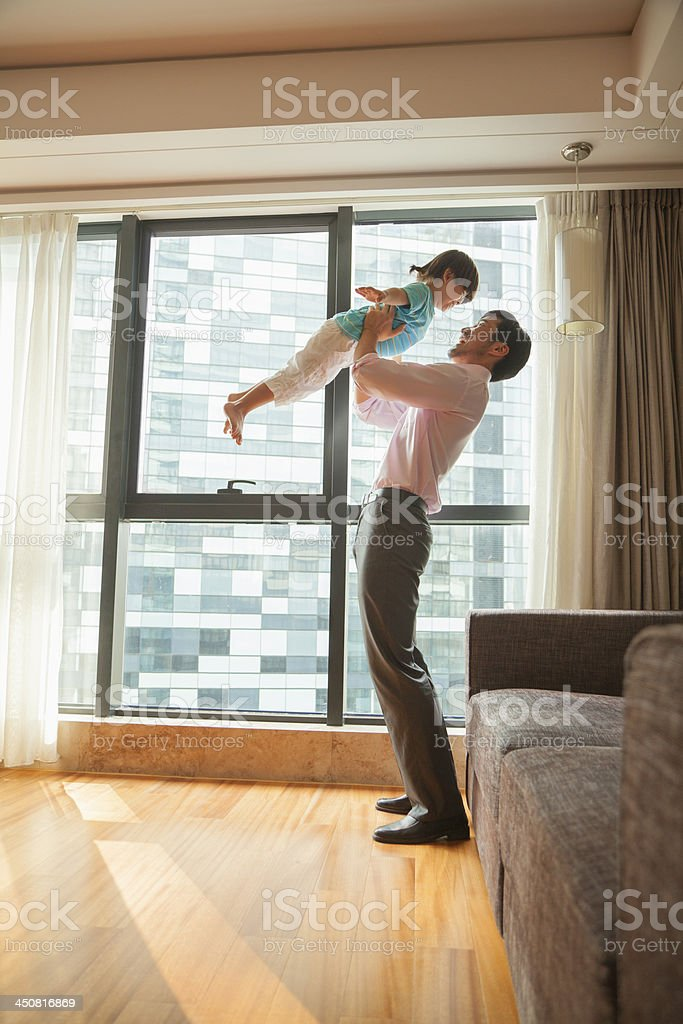 Father playing with his son stock photo
