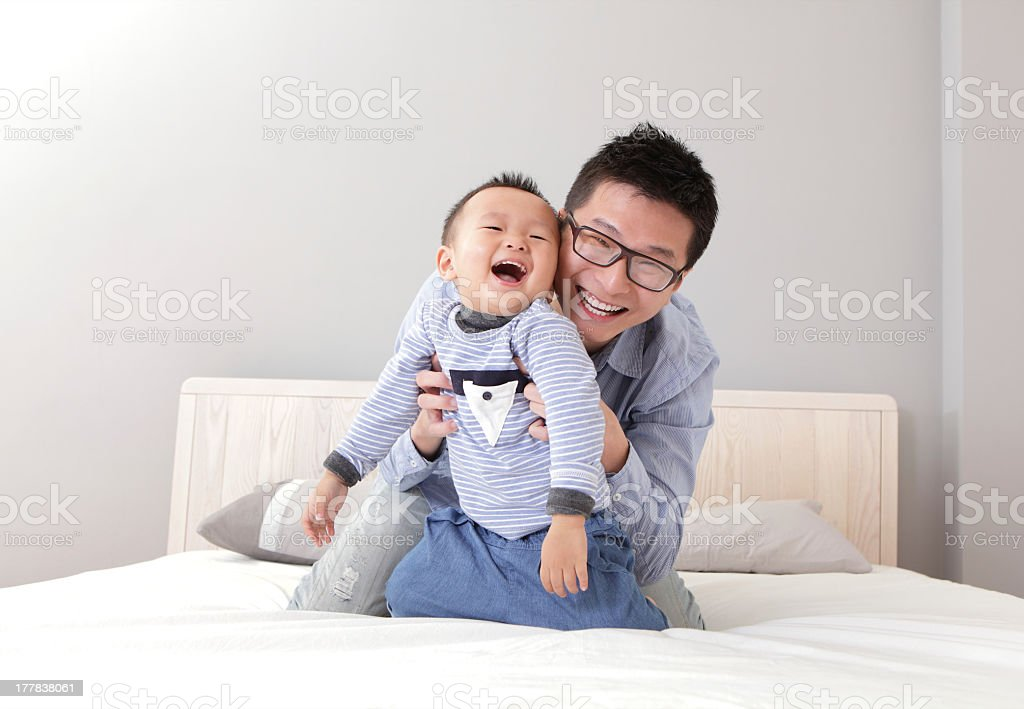 Father playing with his toddler son stock photo