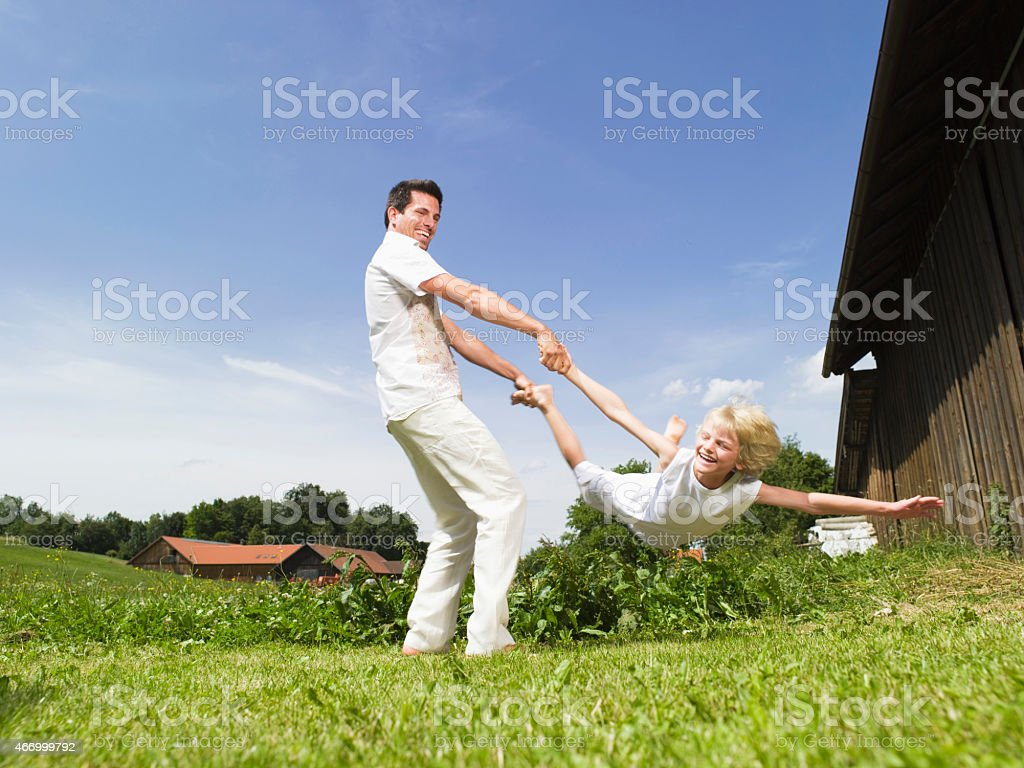 Father playing with son, outdoors stock photo