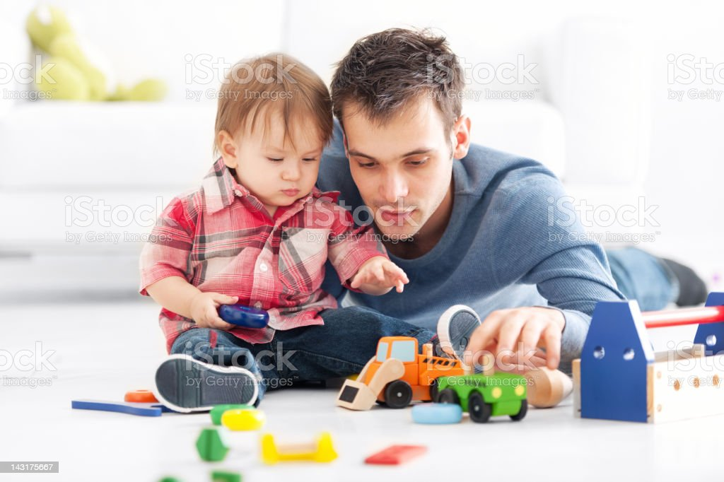 Father playing with son royalty-free stock photo