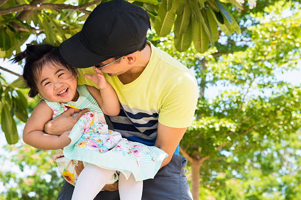 father plays outside with little daughter - philippines girl stock photos and pictures
