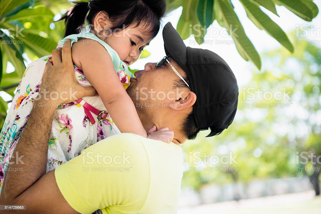 Father Plays Outside with Little Daughter stock photo