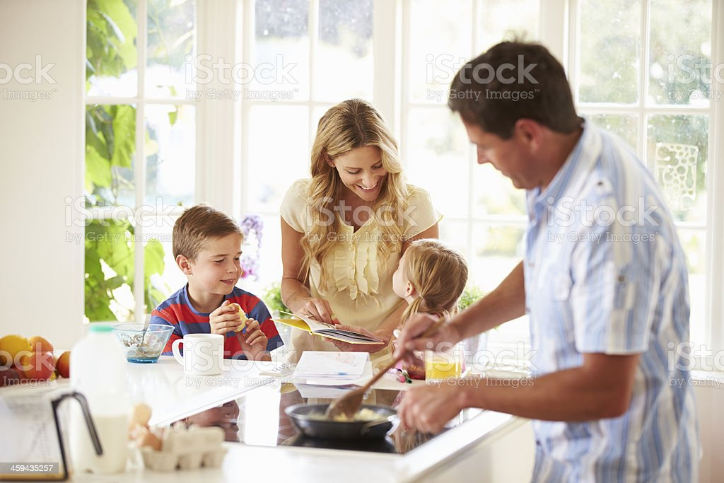 Father prepares a family breakfast in the kitchen stock photo