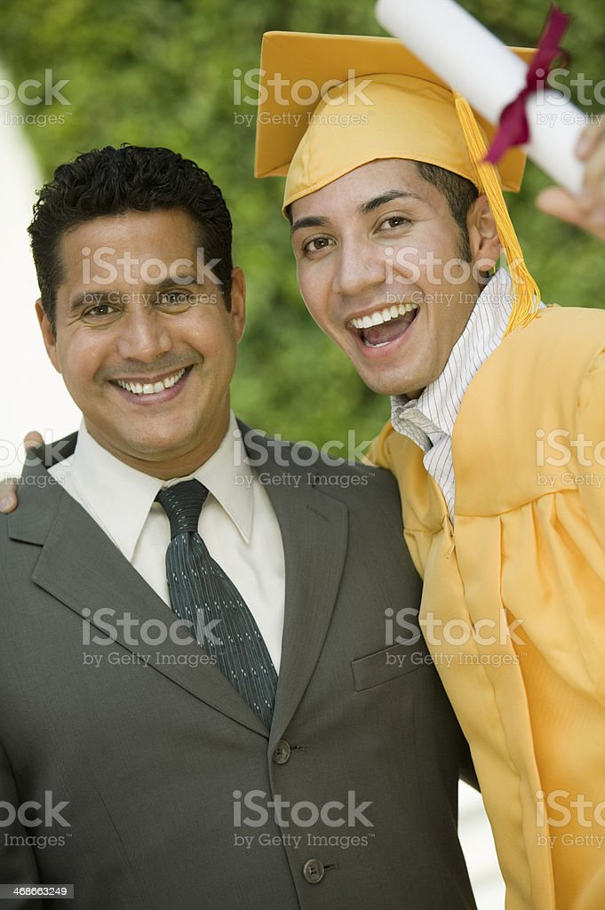 Father Proud of Graduating Son stock photo