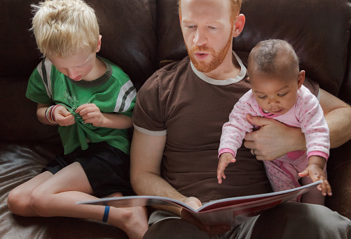 istock Father reading bedtime stories to his children. Multi-ethnic group 467128630