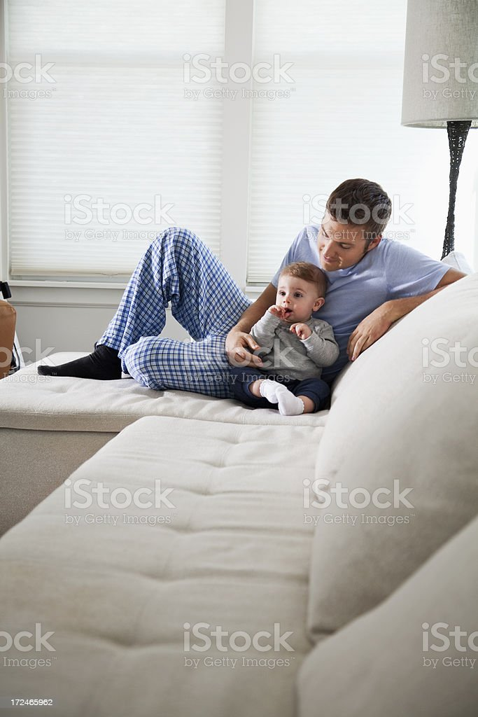 Father relaxing with baby stock photo