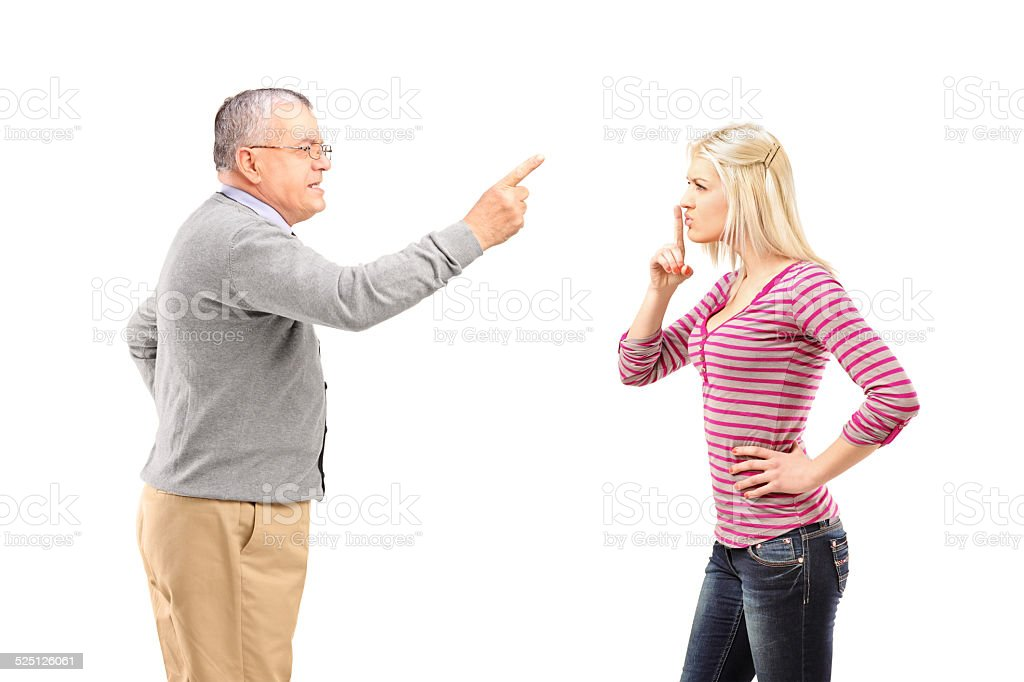 Father reprimending his daughter stock photo