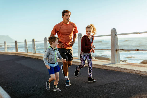 Father running with kids stock photo