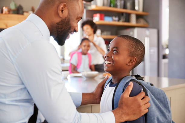 Father Saying Goodbye To Son As He Leaves For School stock photo