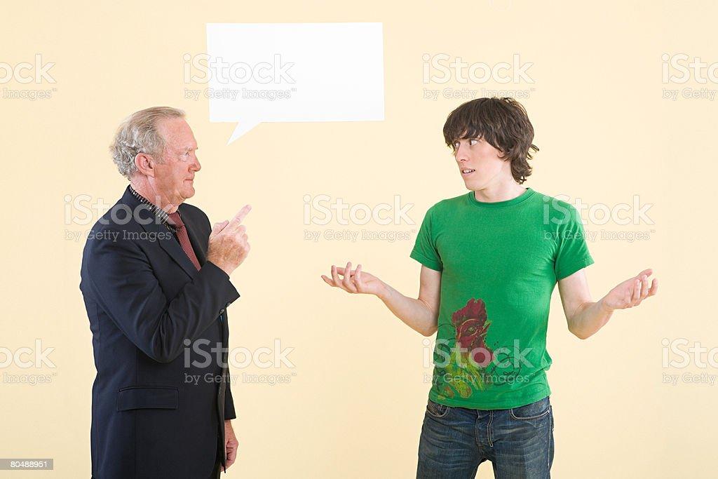 Um pai repreensão o seu filho foto de stock royalty-free