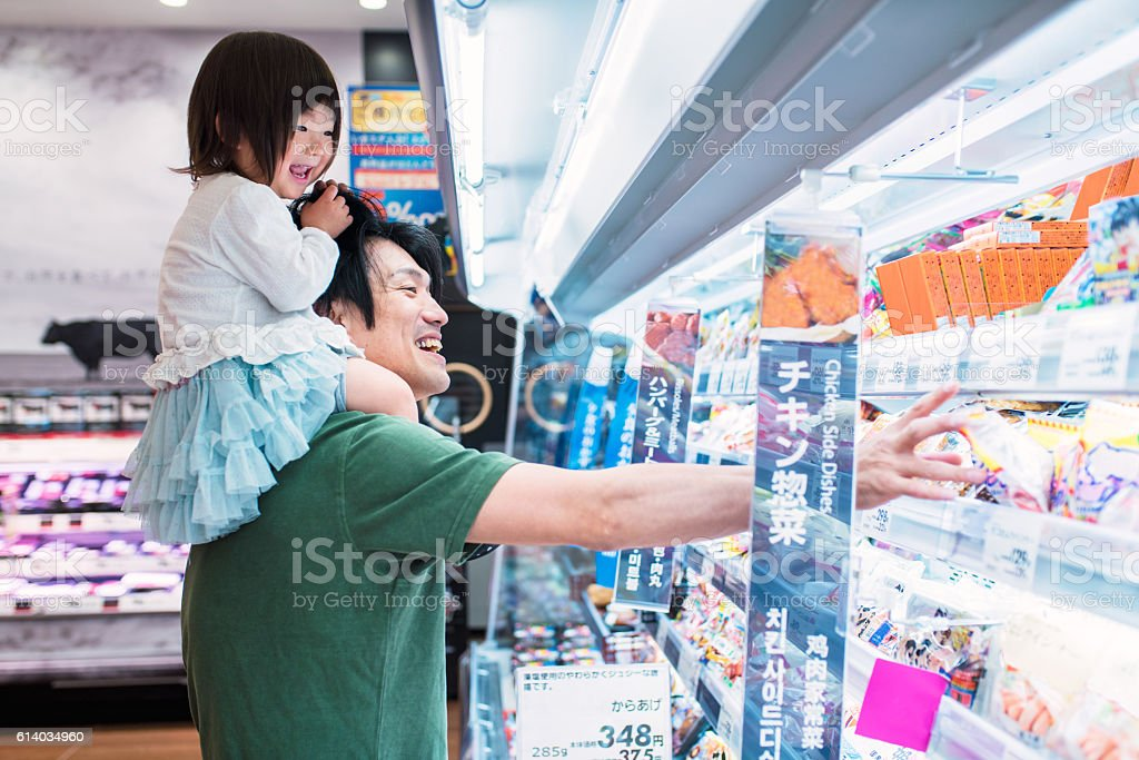 Father shopping with his daughter stock photo