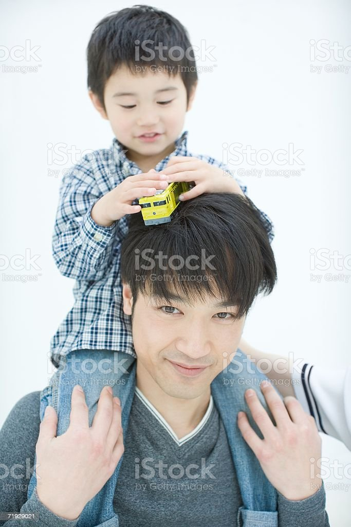 Father shoulder carrying his son royalty-free stock photo