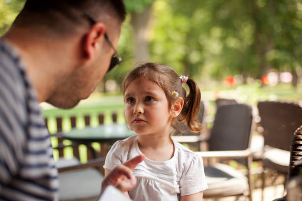 Father Shouting At Young Daughter Angry Father with astonished daughter scolding stock pictures, royalty-free photos & images