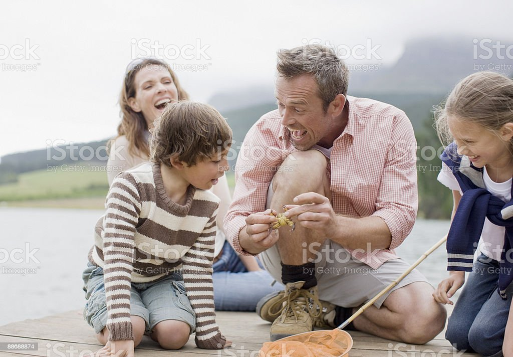 Father showing family small crab royalty-free stock photo