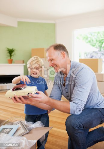 496487362 istock photo Father showing son model car in new house 109350642