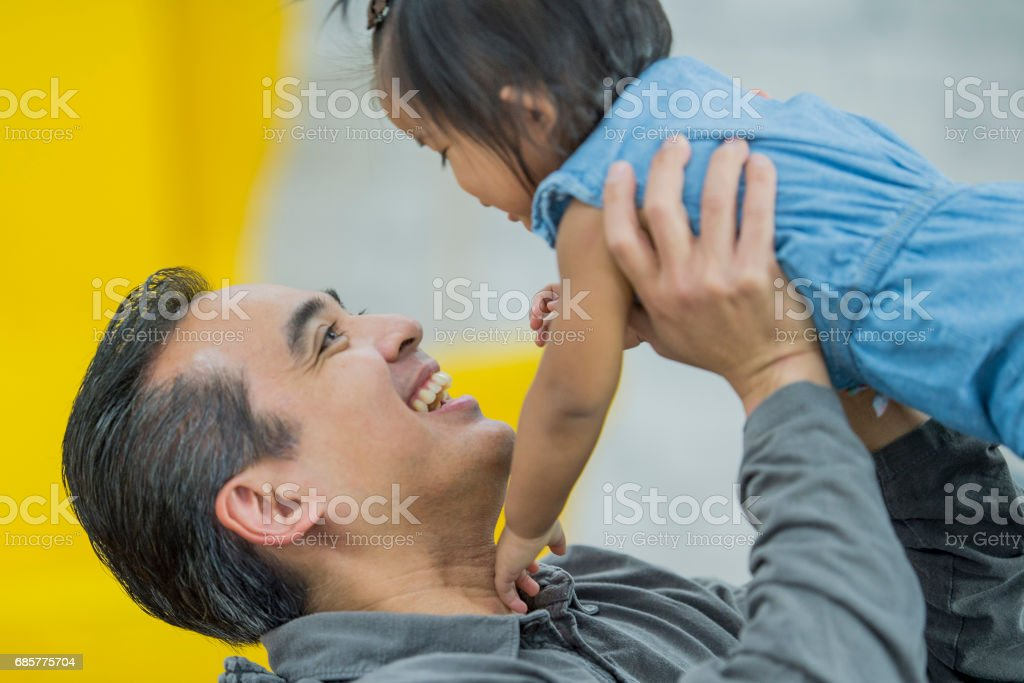 Father Smiling and Holding Baby Girl royalty-free stock photo