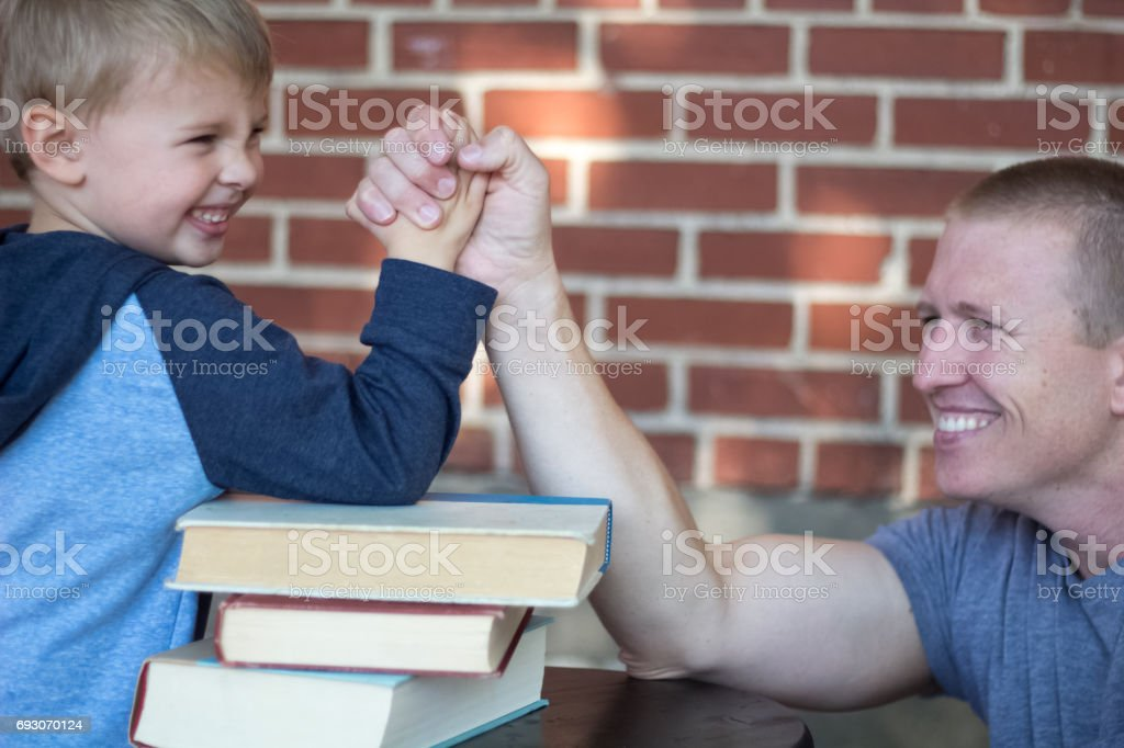Father Son Arm Wrestling stock photo