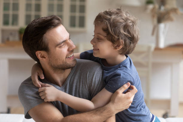 father son having fun playing enjoy funny activities at home - older brother imagens e fotografias de stock