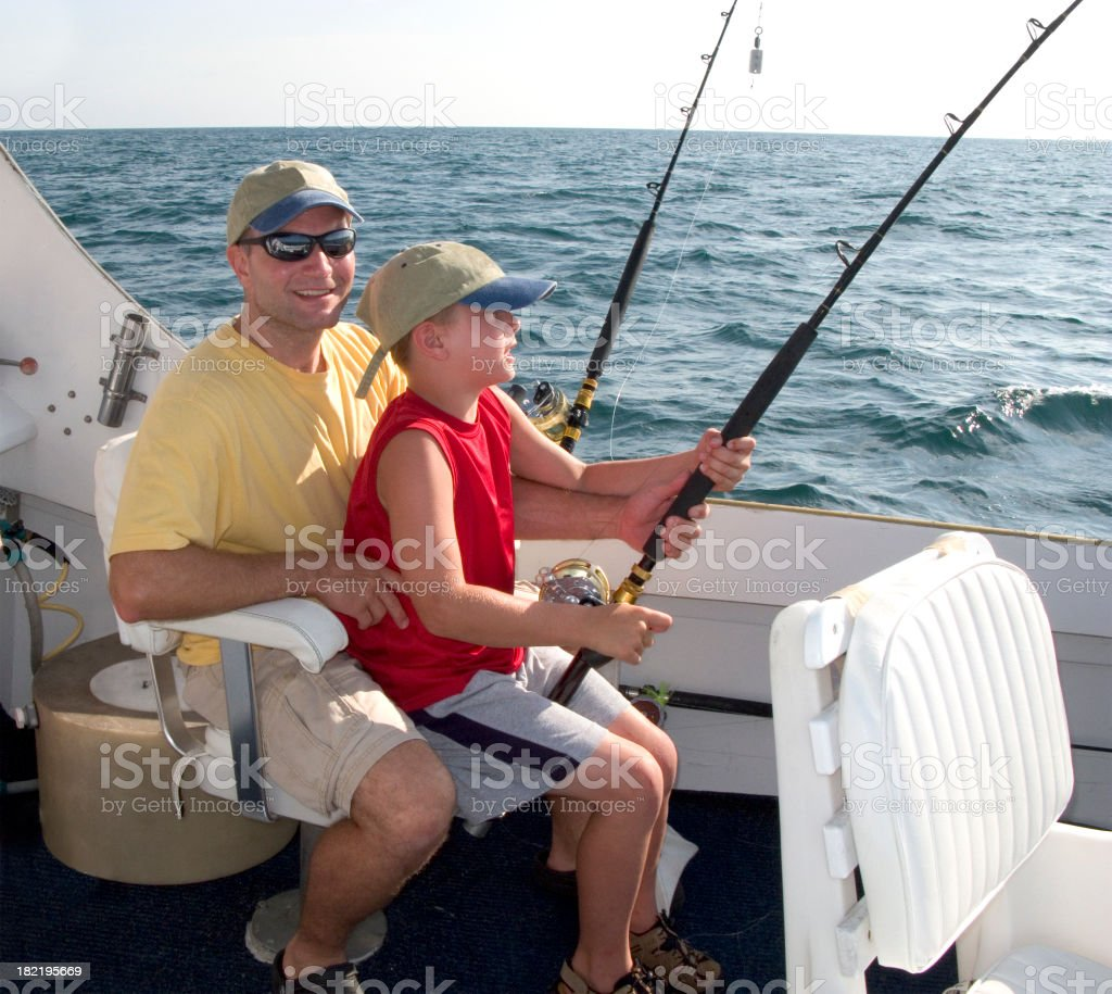 Father & Son (boy) On Charter Fishing Boat stock photo