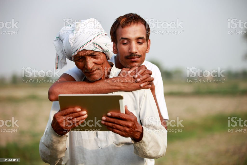Father & son using ipad stock photo