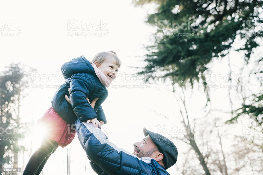 Father Swinging His Daughter stock photo