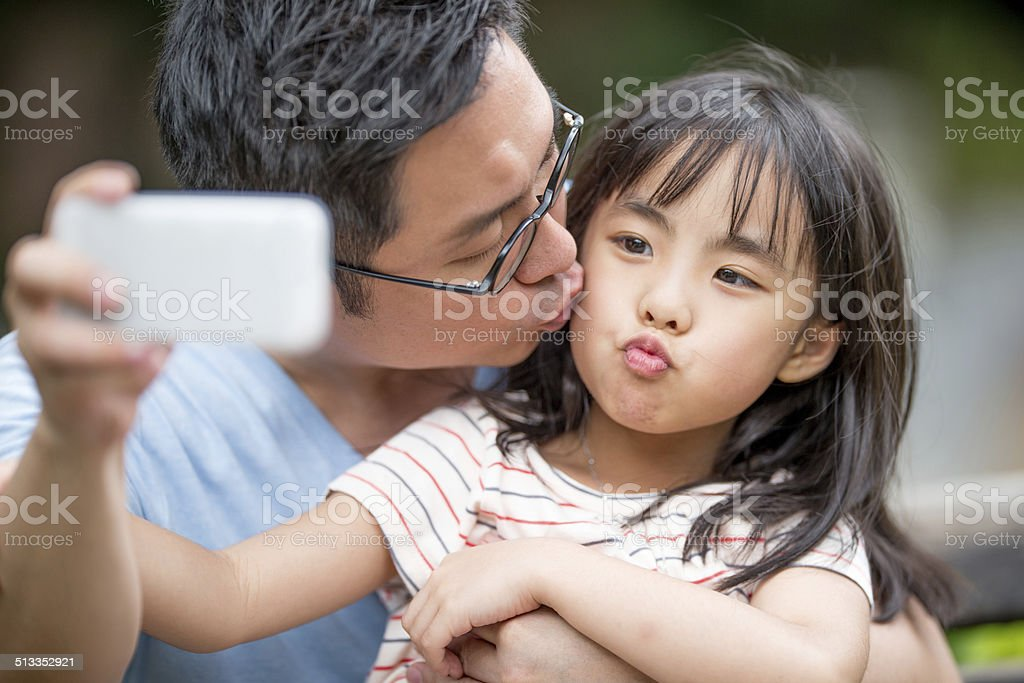 Father taking a selfie with a daughter stock photo