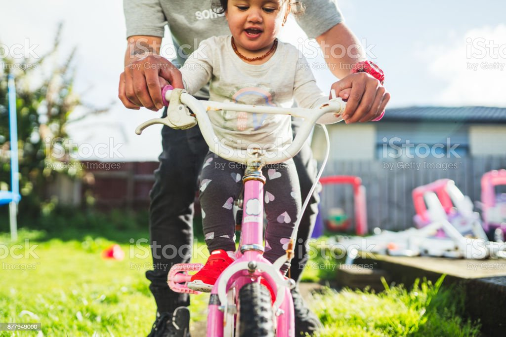 Father taking daughter for a ride. stock photo