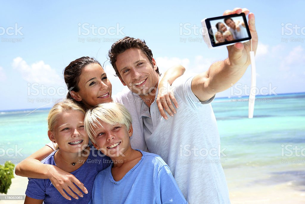 father taking family pictures stock photo