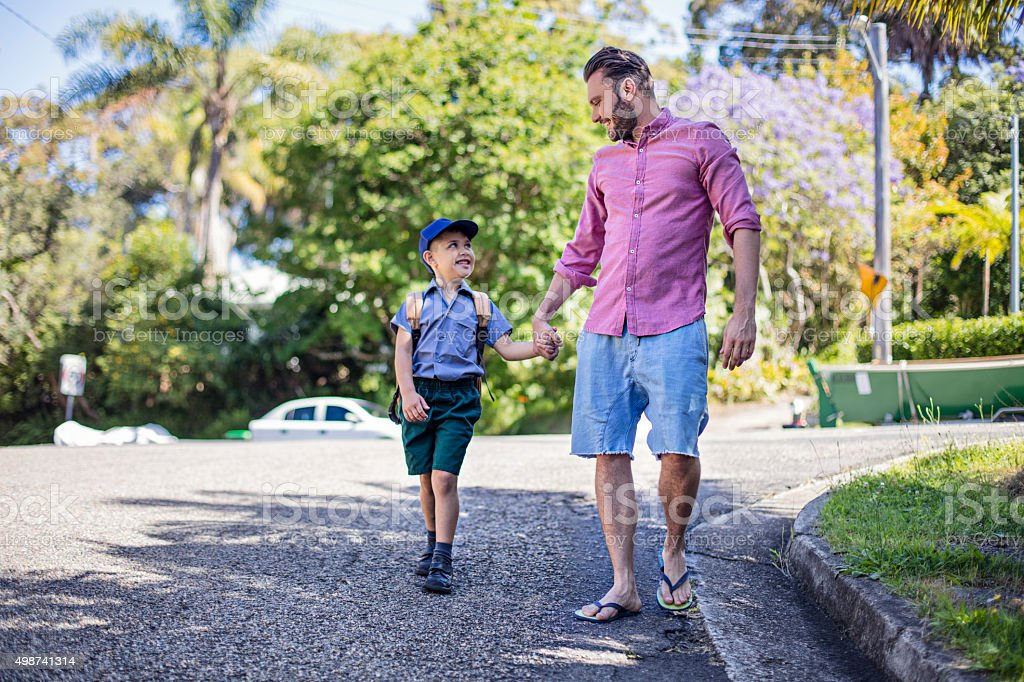 Father taking his son to school stock photo