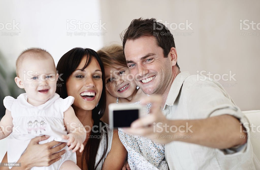 Father taking photos of family royalty-free stock photo