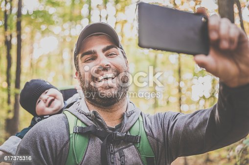 istock Father Taking Selfie with Baby in Forest 617375316