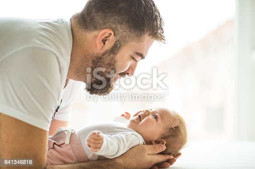 istock Father talking to his baby daughter 641346816