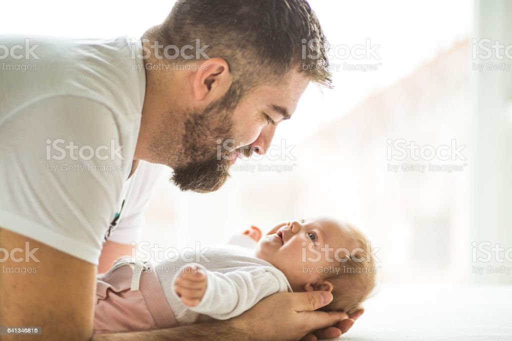 Father talking to his baby daughter stock photo