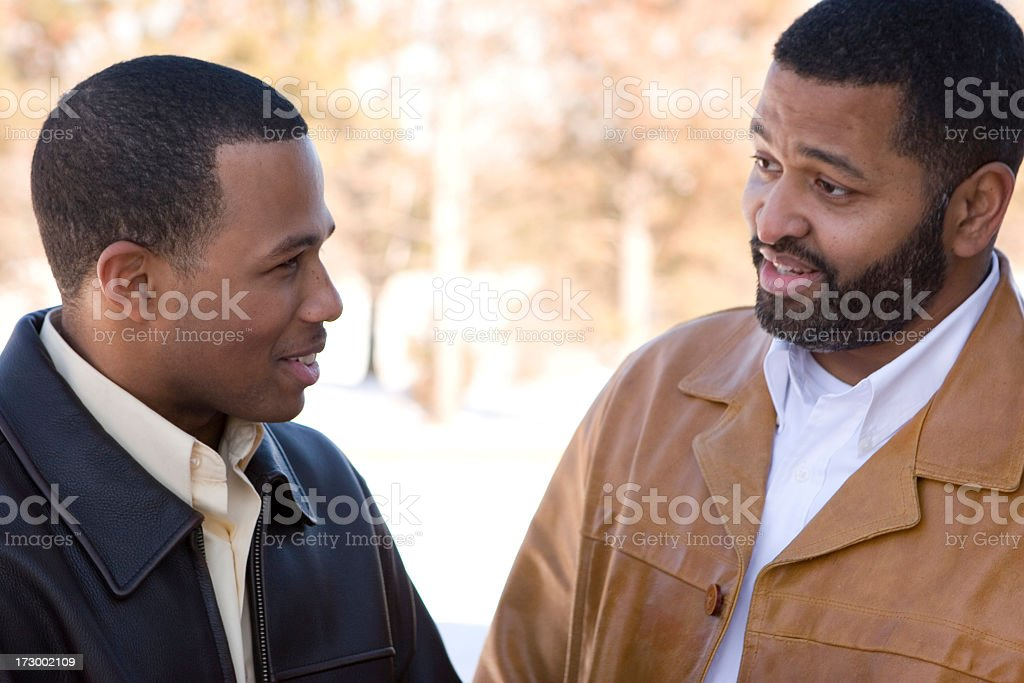 Father talking to his son royalty-free stock photo