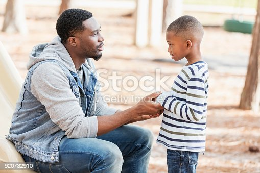 istock Father talking to little boy on playground 920732910