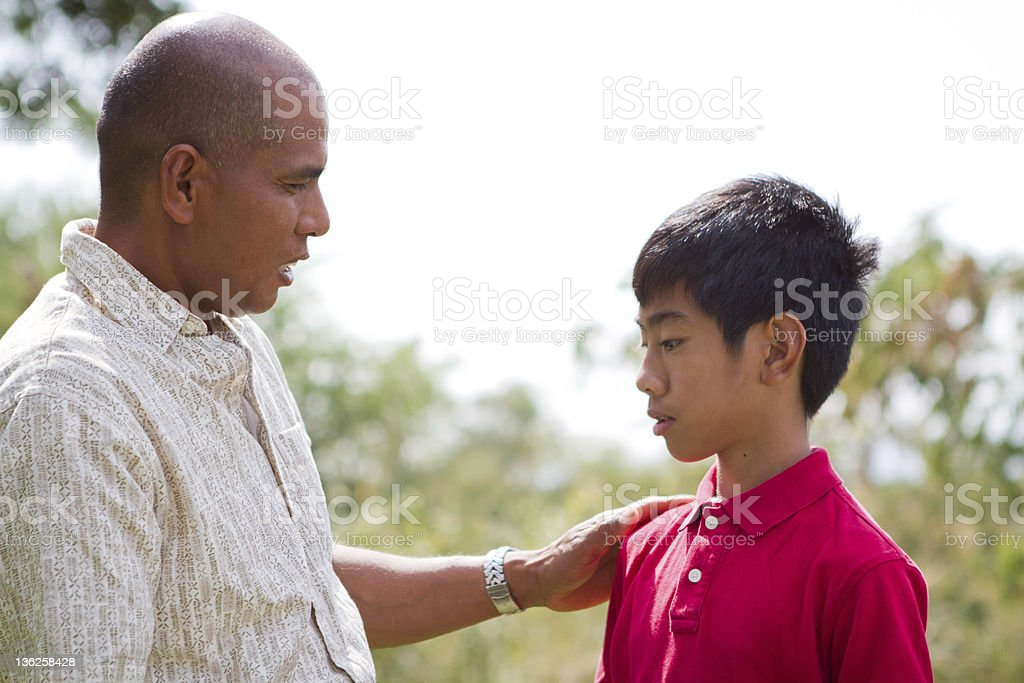 Father Talking To Son stock photo