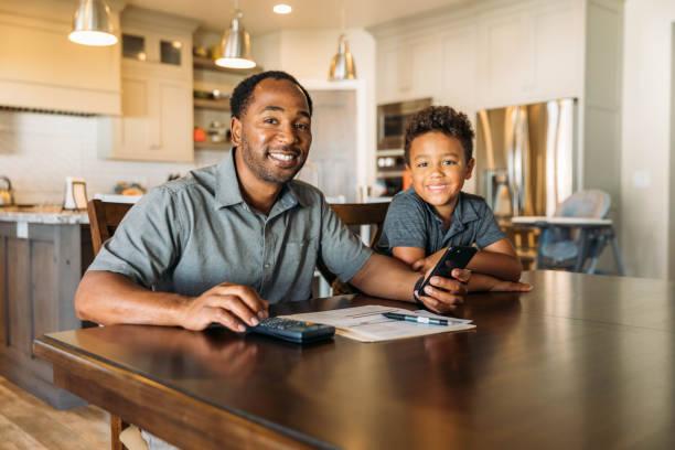Father Teaching Son Home Finances