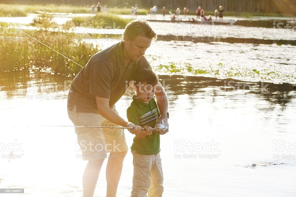 Father Teaching Son To Fish royalty-free stock photo