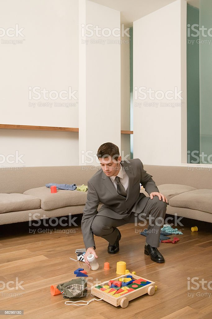 Father tidying up stock photo