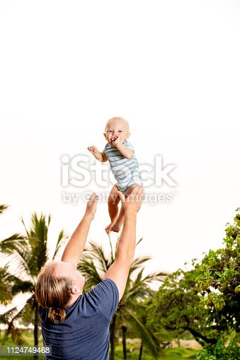 A father tossing and catching his son
