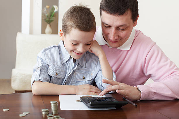 Father training son to the finance stock photo