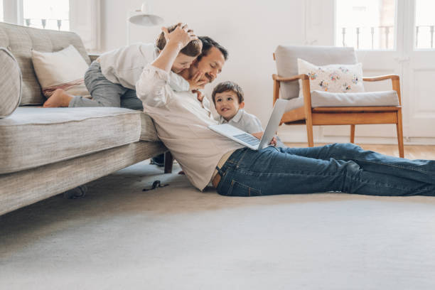 Father trying to work from home stock photo