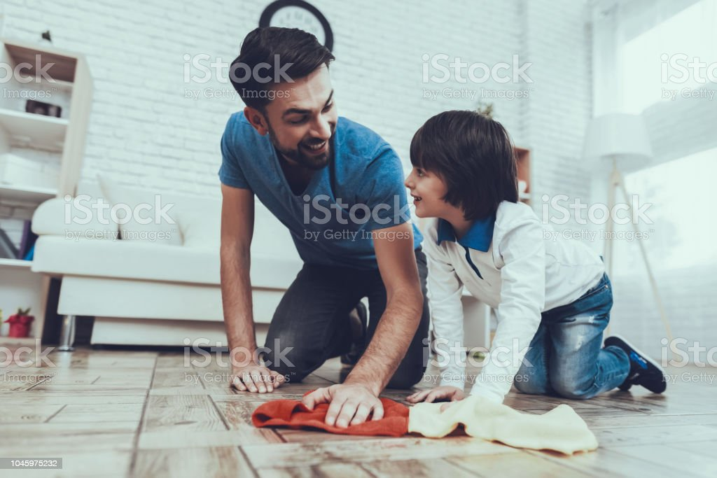 Father Two Boys. Smile. Clean House Together. stock photo