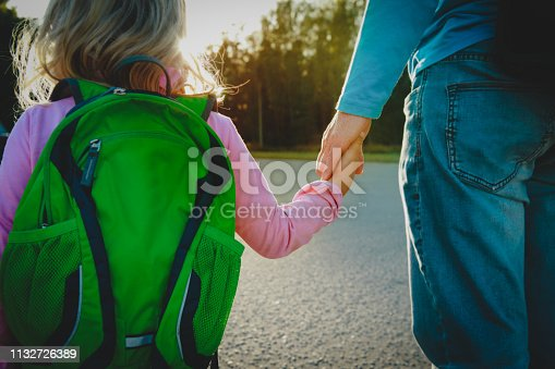 istock father walking little daughter to school or daycare 1132726389