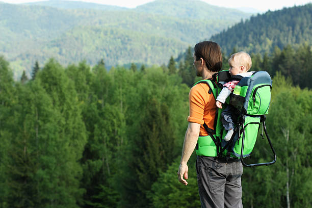 Father with 1 year old son in baby carrier stock photo
