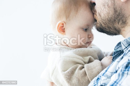istock Father with a infant baby girl. Studio shot. 640252660