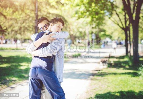 Man holding his autistic son. Autism awareness concept.
