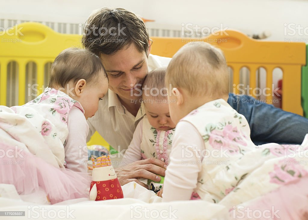 Father with babies stock photo
