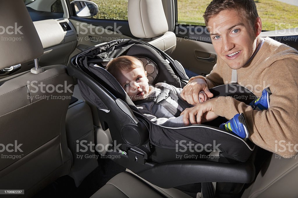 Father with baby in car seat stock photo